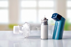 Cartridge inhaler and inhalation chamber in a room front view